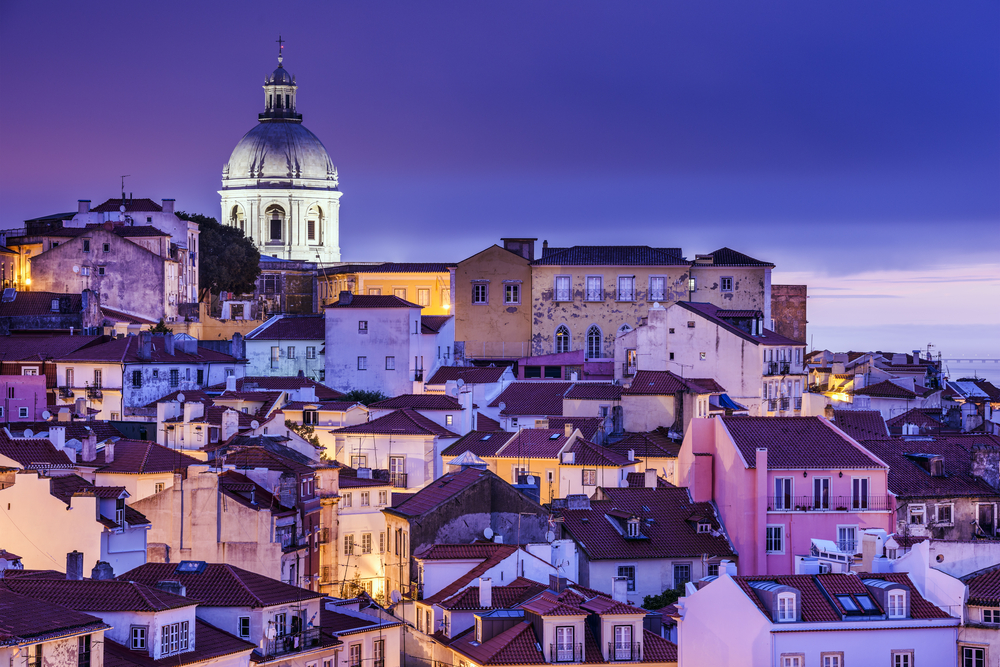 Lisbon, Portugal skyline at Alfama, the oldest district of the city. - Portugal Golden Visa - Savory and Partners